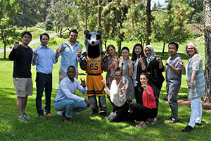Students pose with the school mascot, Peter the Anteater