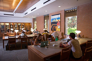 Students study at tables in the law library.