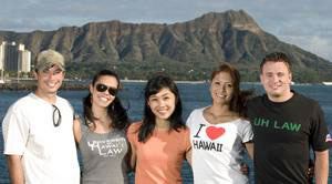 Five students—2 male, 3 female—pose in view of Diamond Head, a volcanic crater.