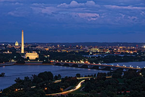 Aerial view of Washington, DC, at night. The Washington Monument is in view.