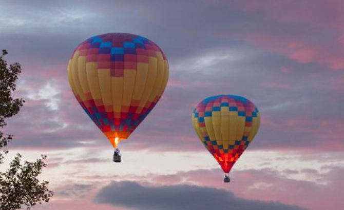 Hot air balloons floating in the sunset