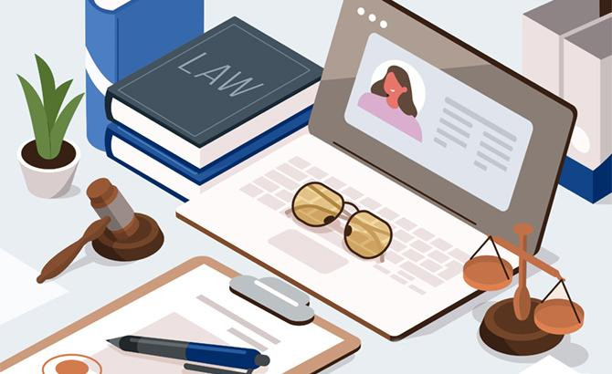 illustration of an open laptop on a desk, surrounded by scales, a gavel, and a law textbook